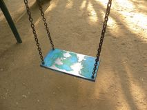Swing set at playground for children.  royalty free stock image