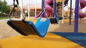 Swing set on playground Stock Images
