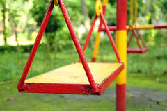 Swing set on a playground Stock Images