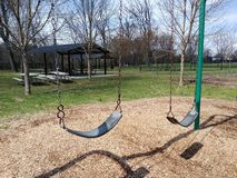 Swing Set in a Playground. Playground in Memorial Park in Rutherford, NJ, USA. This photo was taken on April 13th 2019. swing set playground public parks swings stock photo
