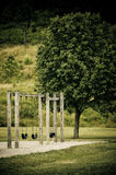 Swing set in public park. Swing set outdoors at a public park royalty free stock images