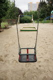 Swing set seat. On metal chains at a playground Stock Images