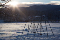 Swing set in winter Stock Photography