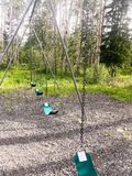 Swing set With Woods royalty free stock photos