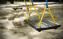 Swing with shadow chain in the playground. For design work Royalty Free Stock Image