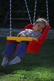 Swing Sleeper. Toddler who fell asleep in her swing royalty free stock photo