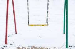 Swing in snow Stock Photos