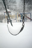 Swing in a snow storm Royalty Free Stock Image
