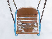 Swing in the snow Royalty Free Stock Image