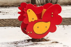 Swing spring rooster on kid playground outdoor Stock Images