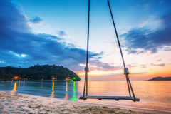 Swing on  sunset at the beach Stock Photography