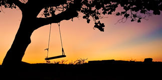 Swing in the sunset. Swing in a colorful sunset royalty free stock photos