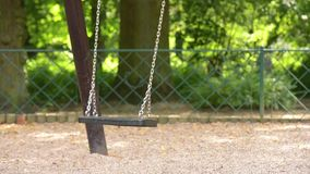 Swing swaying in park stock footage