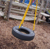 Swing time. Tire swing royalty free stock photography