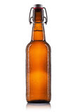 Swing top beer bottle with drops isolated on white background Royalty Free Stock Images