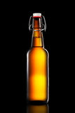 Swing top bottle of light beer isolated on black background Stock Images