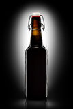 Swing top bottle of light beer isolated on black background Royalty Free Stock Photography