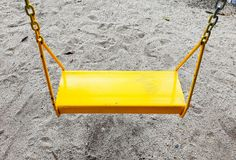 Swing Toy for Children in Playground stock photo