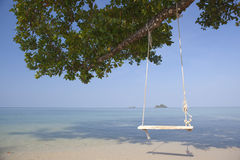 Swing on tropical beach. Royalty Free Stock Images