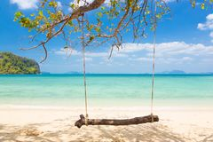 Swing on a tropical beach. Royalty Free Stock Photography