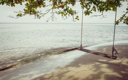 Swing on a tropical beach at Koh Chang island. Stock Photos