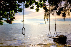 Swing under the sea, bright blue sea. Swing under the sea, bright blue sea, Samui, Thailand Royalty Free Stock Images