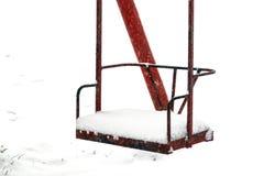 Swing under snow Stock Photos