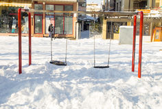 Swing under the snow in the central park of the old town of Pomorie, Bulgaria, winter Stock Image