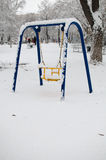 Swing under the snow Royalty Free Stock Images