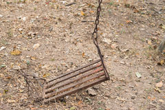 The swing was rust consumes.  Stock Photography