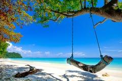 Swing On White Beach Blue Ocean at Rok Island Thailand Stock Photos
