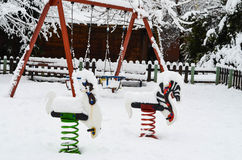 Swing in the winter Stock Photos