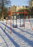 Swing in Winter Park. Winter on the playground swings were empty Stock Photo