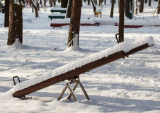 Swing in winter park Royalty Free Stock Image