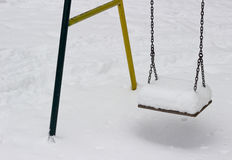 Swing in winter with snow Royalty Free Stock Photos