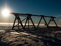 Swing in wintertime. Children swing in winter mountains (Krkonose mountains), Czech republic Stock Photo