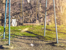 Swing in the yard in early spring Stock Photos
