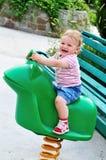 Swinging baby Stock Photo