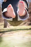 Swinging  Baby: Cute Feet Stock Images
