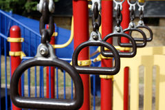 Swinging Bars. At a colorful children's playground Stock Photography