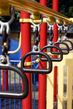 Swinging Bars. At a colorful children's playground Stock Images