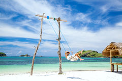 Swinging at the beach Stock Photography