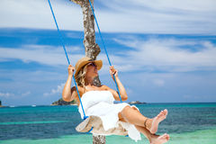 Swinging at the beach Royalty Free Stock Photos