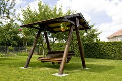 Swinging bench Stock Image