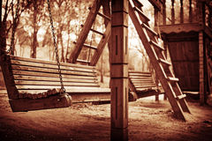 A swinging bench deep. In the woods Stock Photos