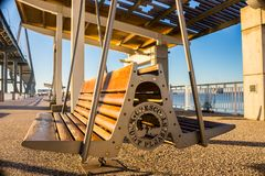 Swinging bench on pier stock image