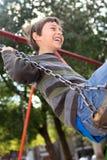 Swinging boy Stock Photo
