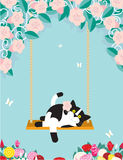 Swinging Cat. A black and white cat is resting on a swing amongst flowers Royalty Free Stock Image