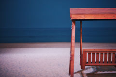 Swinging chair on the beach by the ocean Stock Images