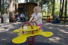 Swinging Child. Young child swinging on a swing Stock Photo